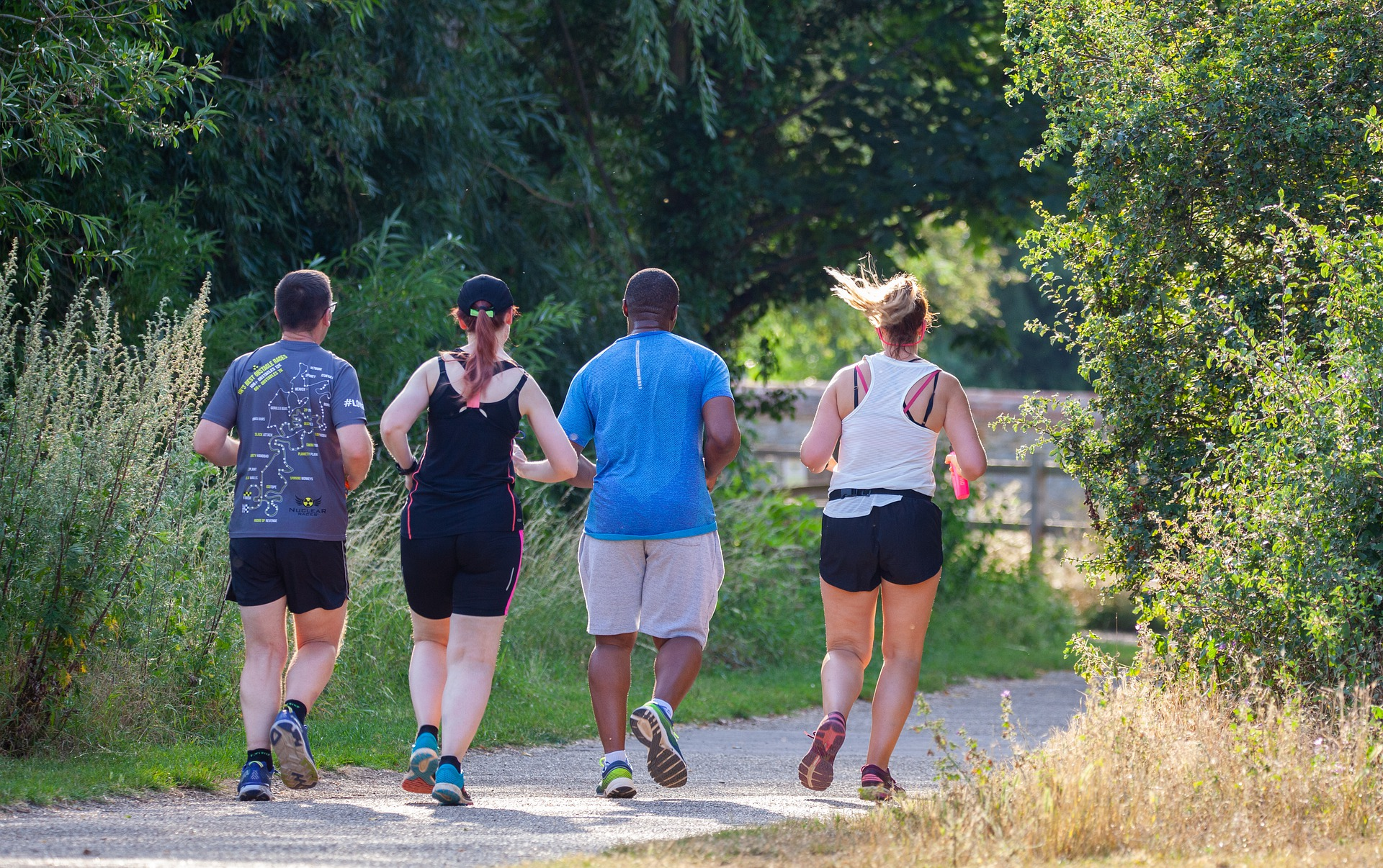 People running on a paved trail.