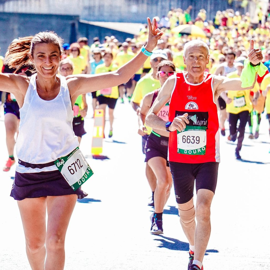 A runner smiles during a race because running is so beneficial.